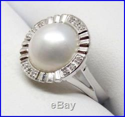 14k WHITE GOLD PAVE SET DIAMONDS AND WHITE MOTHER OF PEARL RING