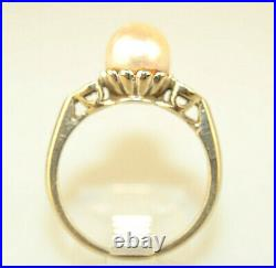 14k White Gold 7.5 MM Pearl Ring With Small Diamonds In Heart Setting On Sides