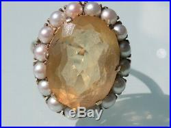 9ct Gold dress ring set with large oval citrine surrounded by seed pearls