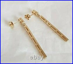 9ct Yellow gold drop earrings. Claw set with twenty two small diamonds