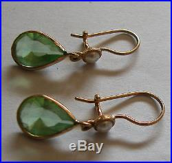 A Fine 9k Yellow Gold Pair Of Earrings Set With Drop Shape Peridot And A Pearl