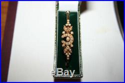 Edwardian15 Ct Gold bangle set with pearls on horseshoe