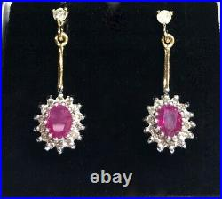 New 9ct Gold Halo Style Drop Earrings set with Rubies & Diamonds. 2.69gra