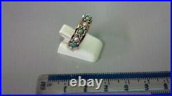 Tested as 9 carat gold Turquoise and half pearl set full eternity ring, size K